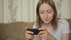 Woman typing text messages on smart phone. At home, closeup shot stock video footage
