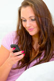 Woman typing text sms message on her mobile Royalty Free Stock Image