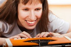 Woman typing typewriter Royalty Free Stock Image
