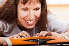 Woman typing typewriter royalty free stock image