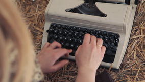 Woman typing on a typewriter close up. Woman typing on a typewriter at hay stock video footage