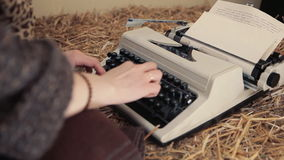 Woman typing on a typewriter close up stock footage
