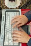 Woman typing very fast on laptop. Royalty Free Stock Photos