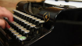 Woman Typing on Vintage Typewriter. Slow motion effect stock footage