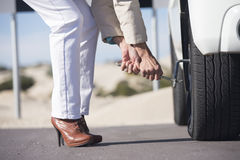 Woman tyre change car break down remote road Royalty Free Stock Photo