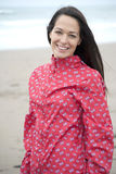 Woman in UK raincoat Stock Image