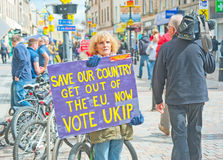 Woman with UKIP sign. Woman holding ' Vote UKIP' sign in High Street Inverness during Westminster Election campaign in May 2015 Royalty Free Stock Photography