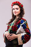 Woman in ukraine national dress. Portrait of cheerful Ukrainian girl wearing national embroidered shirt isolated on white Stock Photography