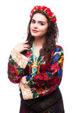 Woman in ukraine national dress. Portrait of cheerful Ukrainian girl wearing national embroidered shirt isolated on white Stock Image