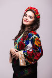 Woman in ukraine national dress. Portrait of cheerful Ukrainian girl wearing national embroidered shirt isolated on white Royalty Free Stock Photography