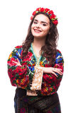 Woman in ukraine national dress. Portrait of cheerful Ukrainian girl wearing national embroidered shirt isolated on white Royalty Free Stock Photo