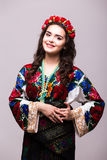 Woman in ukraine national dress. Portrait of cheerful Ukrainian girl wearing national embroidered shirt isolated on white Royalty Free Stock Photos