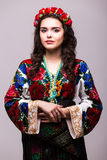 Woman in ukraine national dress. Portrait of cheerful Ukrainian girl wearing national embroidered shirt isolated on white Stock Photos