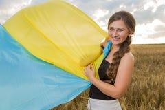 Woman with a Ukrainian flag Stock Photo