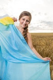 Woman with a Ukrainian flag Royalty Free Stock Photo