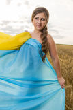 Woman with a Ukrainian flag Stock Photos