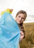 Woman with a Ukrainian flag Royalty Free Stock Photos