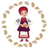 Woman in the Ukrainian national costume holding a plate Royalty Free Stock Photos
