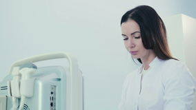 Woman with an ultrasound diagnostic tool stock video footage