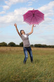 The woman and a umbrella Stock Photography