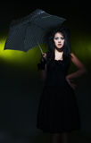Woman and umbrella Stock Photos