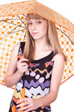 Woman with umbrella. Portrait of the beautiful girl holding a yellow umbrella symbolizing protection and insurance on a white background Stock Image