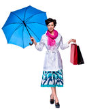 Woman with umbrella. Isolated portrait of a beautiful business woman holding a blue umbrella. Concept of support, protection, insurance. Isolate Stock Photo