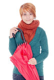Woman with umbrella. Young woman with umbrella and scarf on a winter day Stock Photo