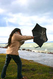 Woman with umbrella. Digital photo of a woman with an umbrella at a stormy sea Royalty Free Stock Photography