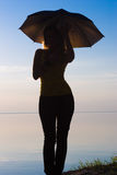 Woman with umbrella Stock Image