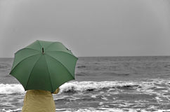 Woman with umbrella on the beach Royalty Free Stock Photography