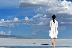Woman With Umbrella on Beach stock images