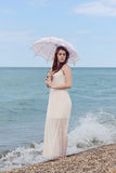 Woman with umbrella at the beach Royalty Free Stock Photography