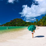 Woman with umbrella at beautiful beach Royalty Free Stock Photos