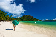 Woman with umbrella at beautiful beach Royalty Free Stock Images