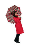Woman with umbrella. Beautiful brown-haired woman with umbrella Stock Images
