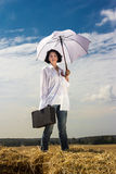 Woman with umbrella and a box. Beautiful woman with umbrella and a box stock photography