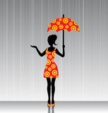 Woman with an umbrella in a bright dress Stock Photography