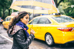 Woman with umbrella crossing a street Royalty Free Stock Image