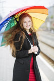 Woman with umbrella enjoy the weather Stock Photos