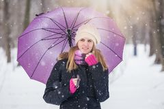 Portrait of beautiful young woman on snowy day. royalty free stock photos
