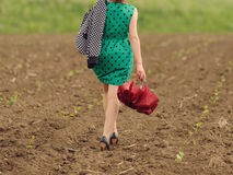 Woman with Umbrella in Field Stock Photography