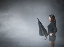 Woman with umbrella on hand Stock Photography