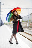 Woman with umbrella look at feet Royalty Free Stock Images