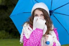 Woman with umbrella looking for rain Stock Photos