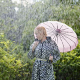 Woman and umbrella Stock Photos