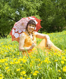 Woman with umbrella on meadow with dandelions Royalty Free Stock Photos