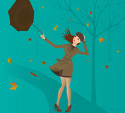 Woman with umbrella in the park in autumn. Stock Photography