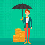 Woman with umbrella protecting money. Royalty Free Stock Images
