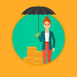 Woman with umbrella protecting money. Royalty Free Stock Photography